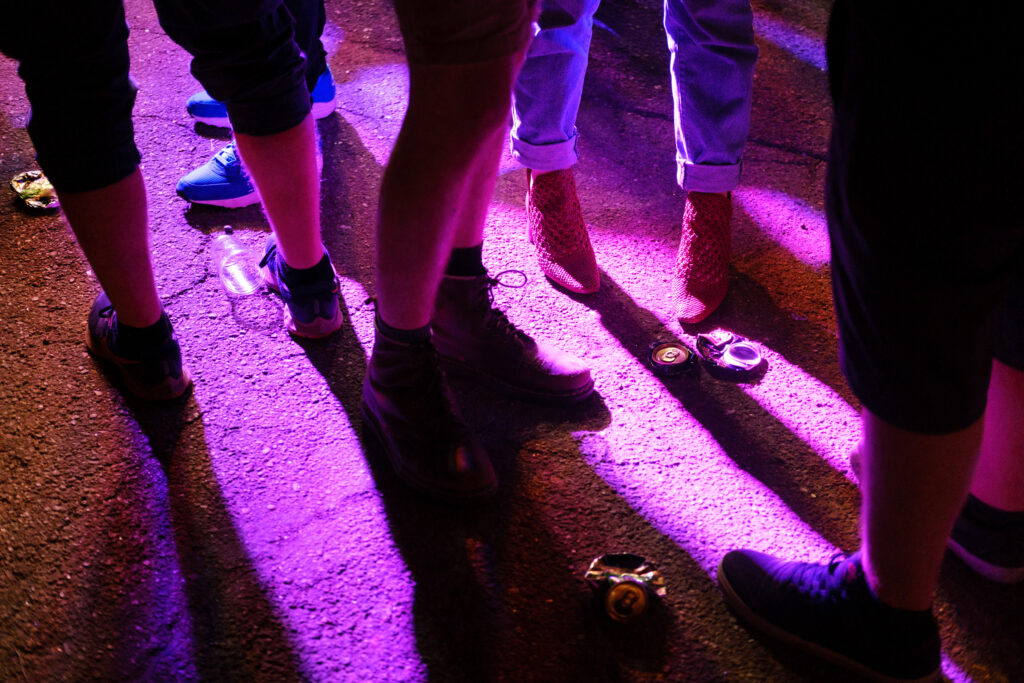 Cans and cups dot the ground after Pinegrove's performance at the Underground Music Showcase main stage in Denver on Friday, August 27, 2021.