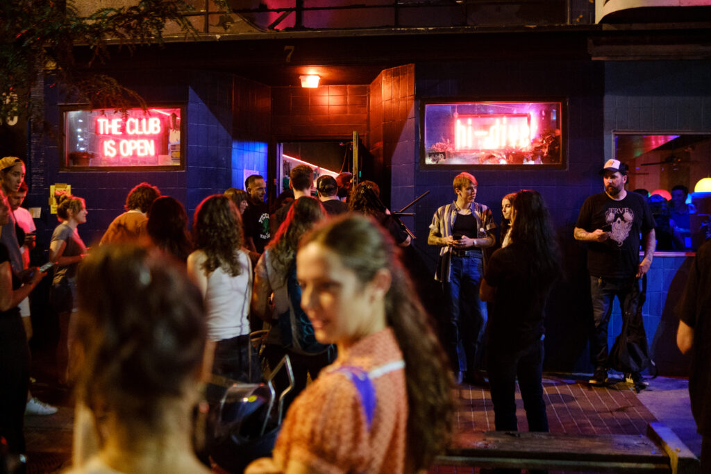 People wait outside Hi-Dive on Broadway to see a show, part of the Underground Music Showcase in Denver on Friday, August 27, 2021.