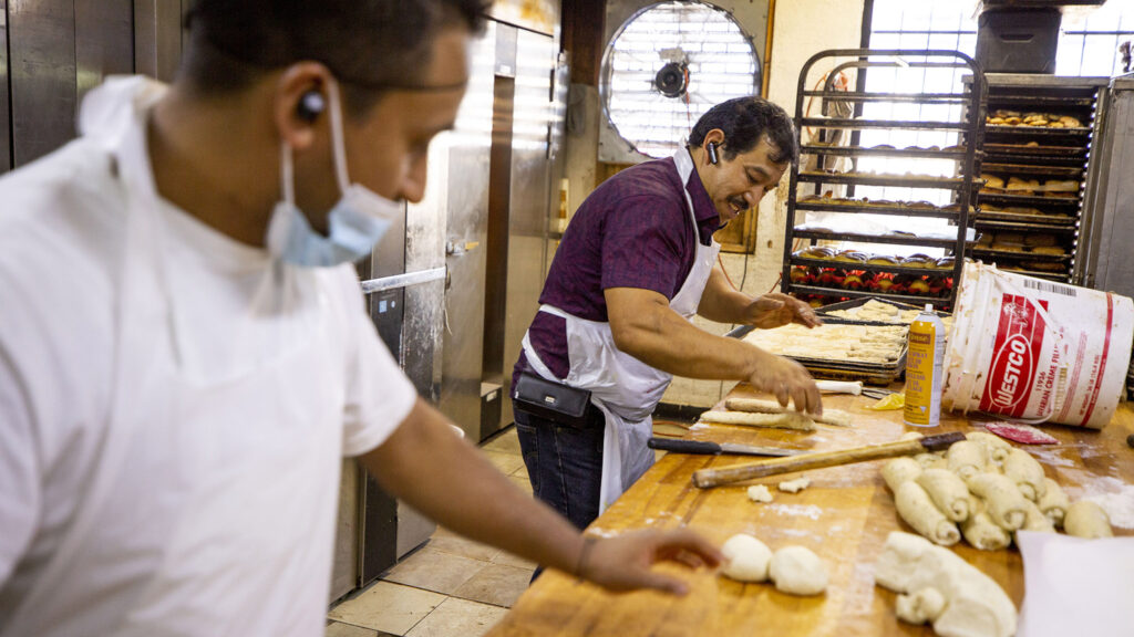 Manuel Contreras (right) spins dough at his panaderia on Morrison Road. Sept. 10, 2021.