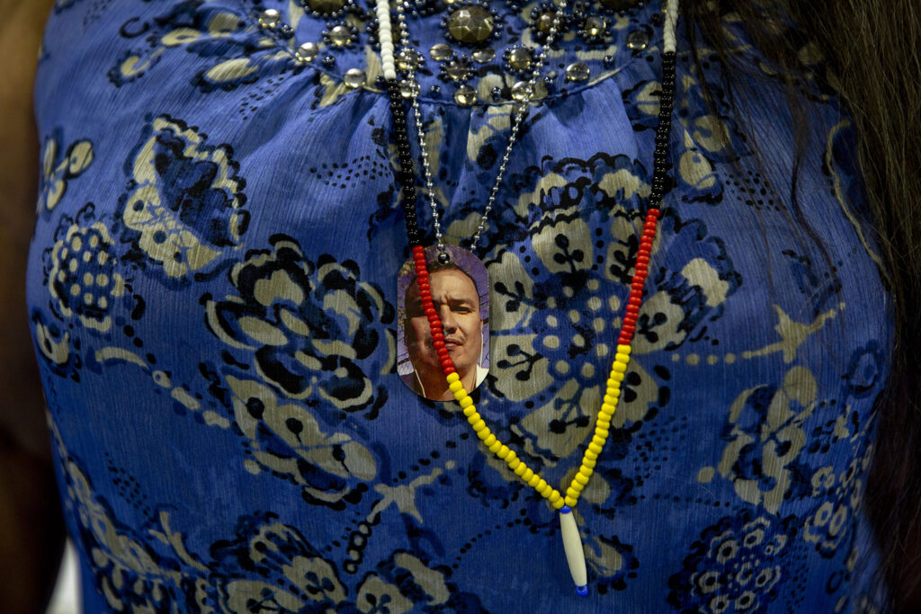 Lynn Eagle Feather carries a photo of her son, Paul Castaway, on a necklace. Sept. 14, 2021.