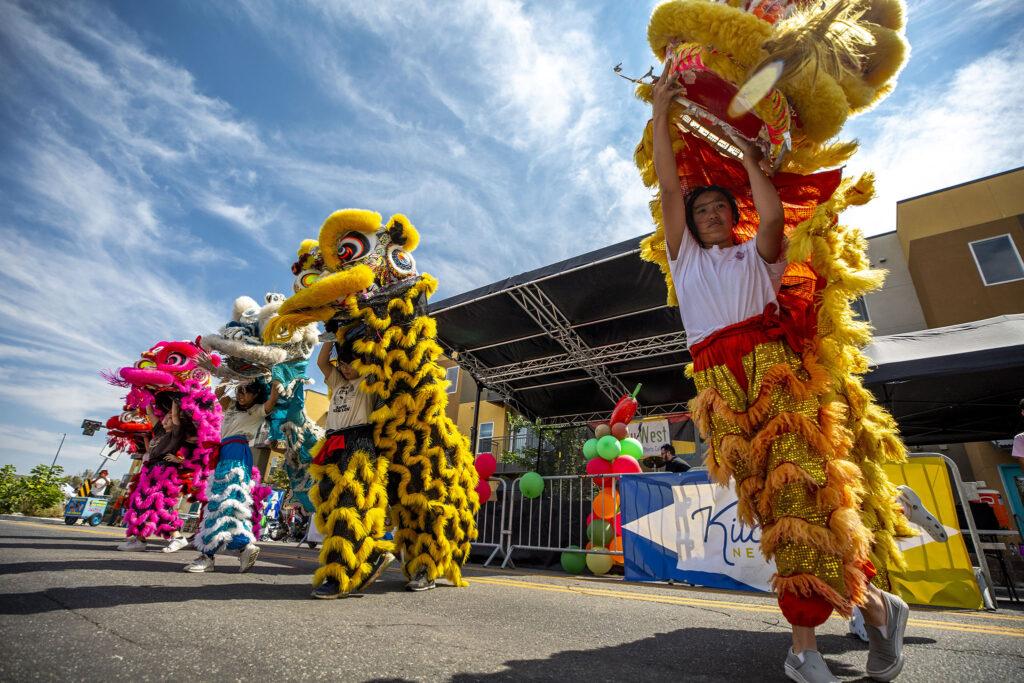 The GDPT Nguyen Thieu line dancers perform a lion dance at the Westwood Chile Fest on Morrison Road. Sept. 11, 2021.