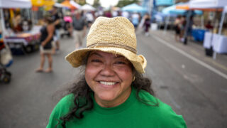 Irma Díaz, of the Mujeres Emprendedoras Cooperative, stands on Morrison Road during the Westwood Chile Fest. Sept. 11, 2021.