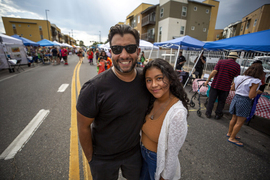 Denver Clerk and Recorder Paul Lopez stands on Morrison Road with his daughter, Nayeli, during the Westwood Chile Fest. Sept. 11, 2021.