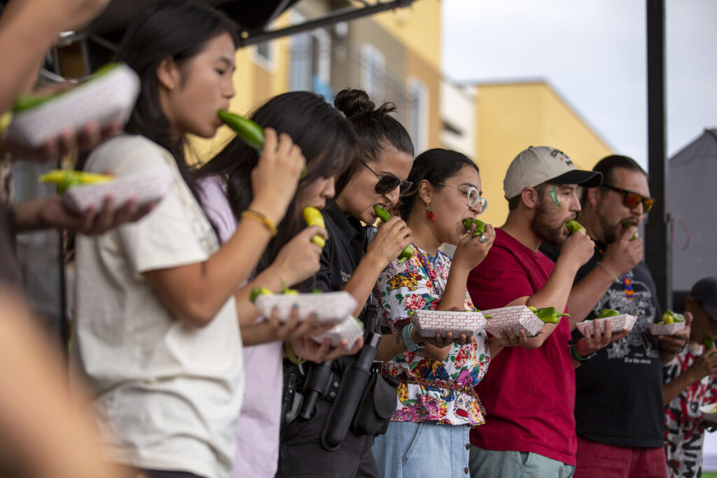 Contestants down spicy chiles during an eating contest at the Westwood Chile Fest. Sept. 11, 2021.