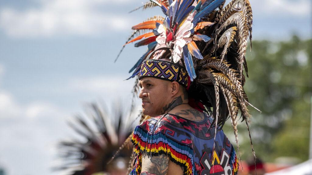 Santiago Jaramillo, a member of Kalpulli Tepeyollotl, performs an indigenous Aztec dance on Morrison Road during the Westwood Chile Fest. Sept. 11, 2021.