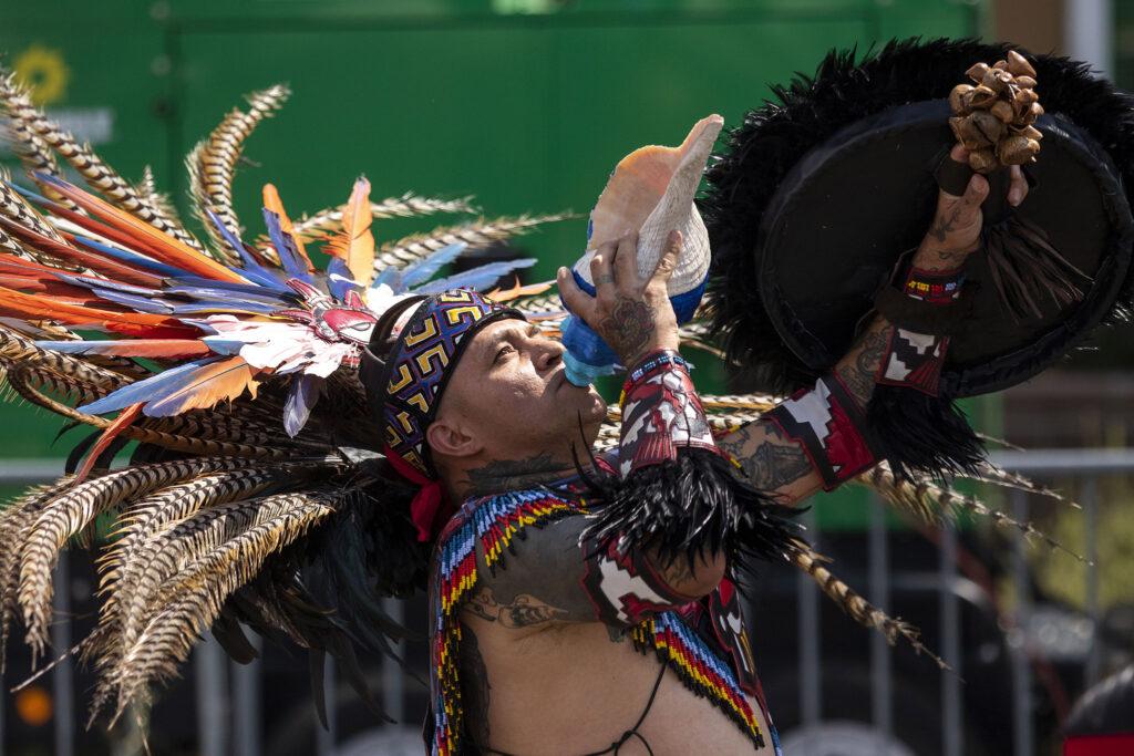 Santiago Jaramillo, a member of Kalpulli Tepeyollotl, blesses the land around Morrison Road before an indigenous Aztec dance during the Westwood Chile Fest. Sept. 11, 2021.