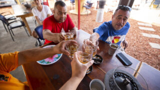 Boogie Down owner Ron Martinez (right) and Ed Martinez  cheers a reporter on Boogie Down's Morrison Road patio. Sept. 13, 2021.