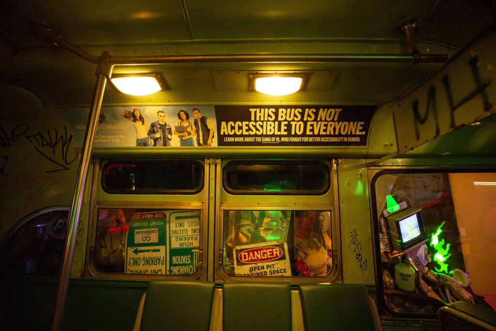 An ad inside an RTD bus at Meow Wolf Denver: Convergence Station is a notice about some Denver history. Sept. 13, 2021.