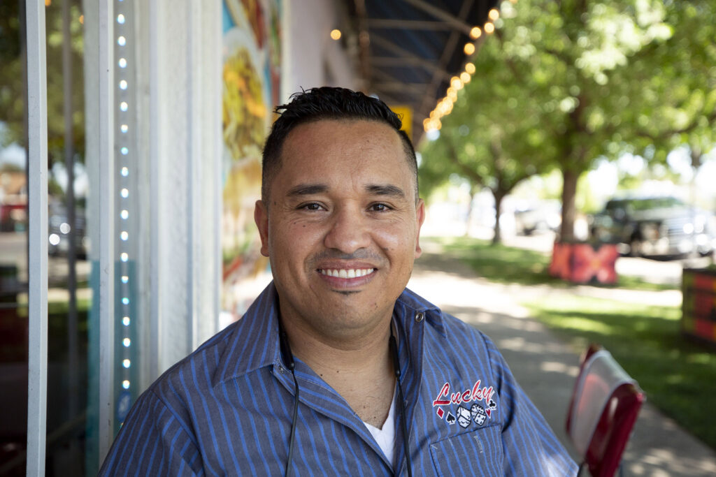Hector Soto sits in front of Bule Bule, his ice cream shop on Morrison Road, Sept. 16, 2021.