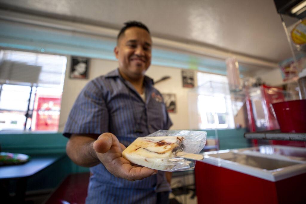 Hector Soto holds a paleta de gansito at his shop, Bule Bule, on Morrison Road. Sept. 16, 2021.