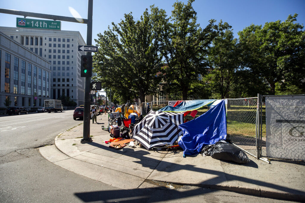 Civic Center Park is closed, and there are a lot of tents set up across 14th Avenue around the library and art museum. Sept. 15, 2021.