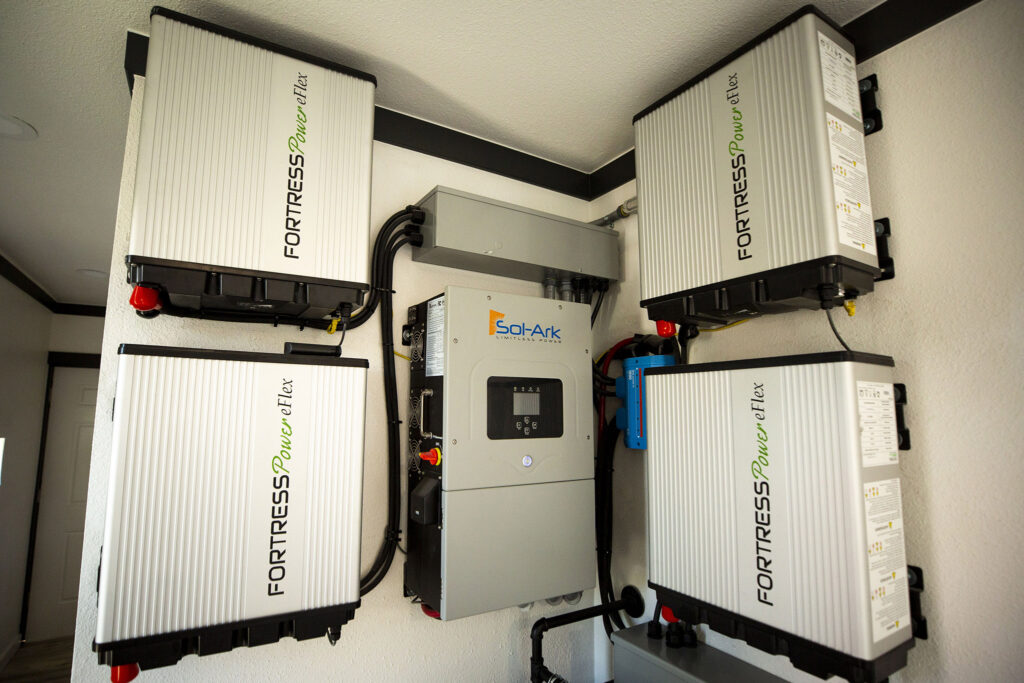 A solar battery system Inside a model Stackhouse home in a parking lot along West Colfax. Sept. 15, 2021.