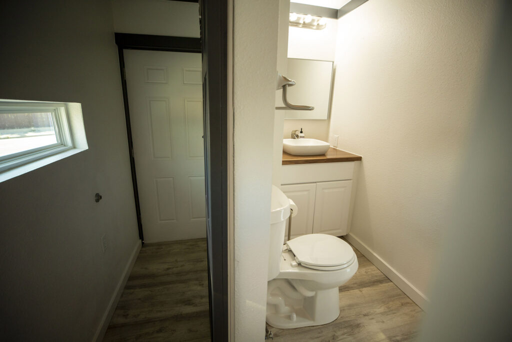 The bathroom inside a model Stackhouse home in a parking lot along West Colfax. Sept. 15, 2021.