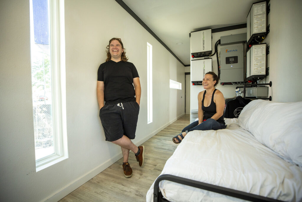 Janelle Briggs and Ryan Egan stand inside a model Stackhouse home in a parking lot along West Colfax. Sept. 15, 2021.