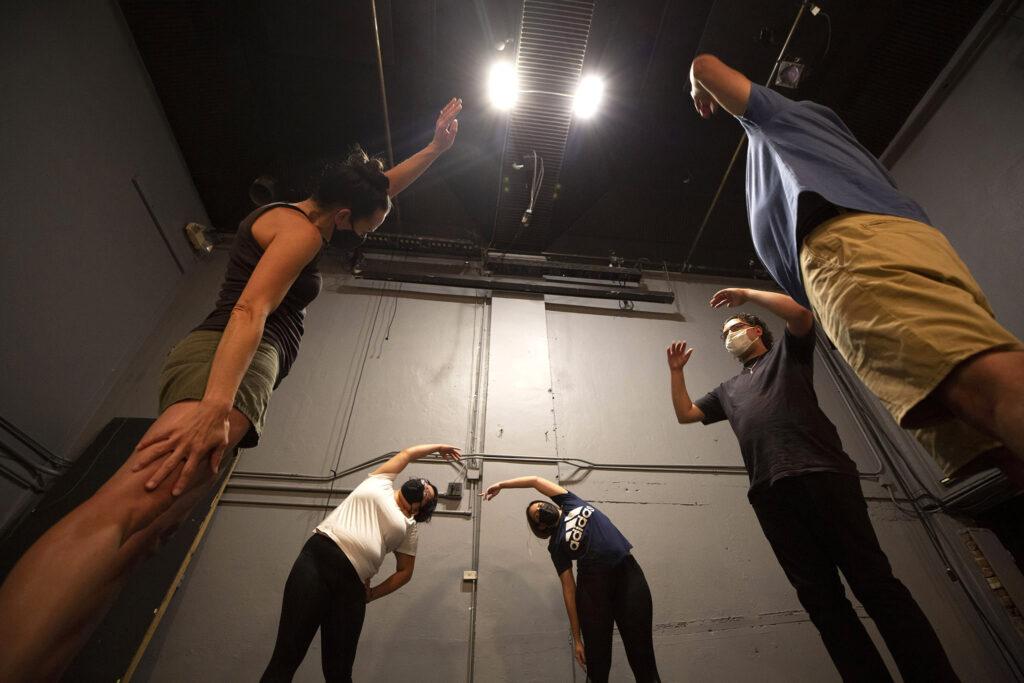 """The cast of """"El Corrido del Barrio"""" warms up before rehearsal at Su Teatro. Sept. 15, 2021."""