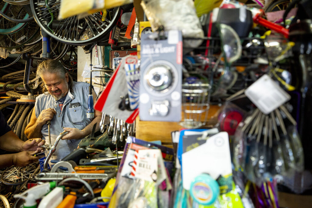Thomas Padilla at work inside One Stop Bike Shop on Morrison Road. Westwood, Sept. 21, 2021.