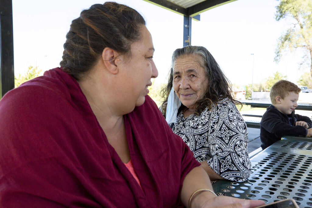 Mujeres Emprendedoras members Maria Rubio (right) and Anotina Garcia sit in Westwood's Quatro Vientos Park, not far from Morrison Road. Sept. 22, 2021.