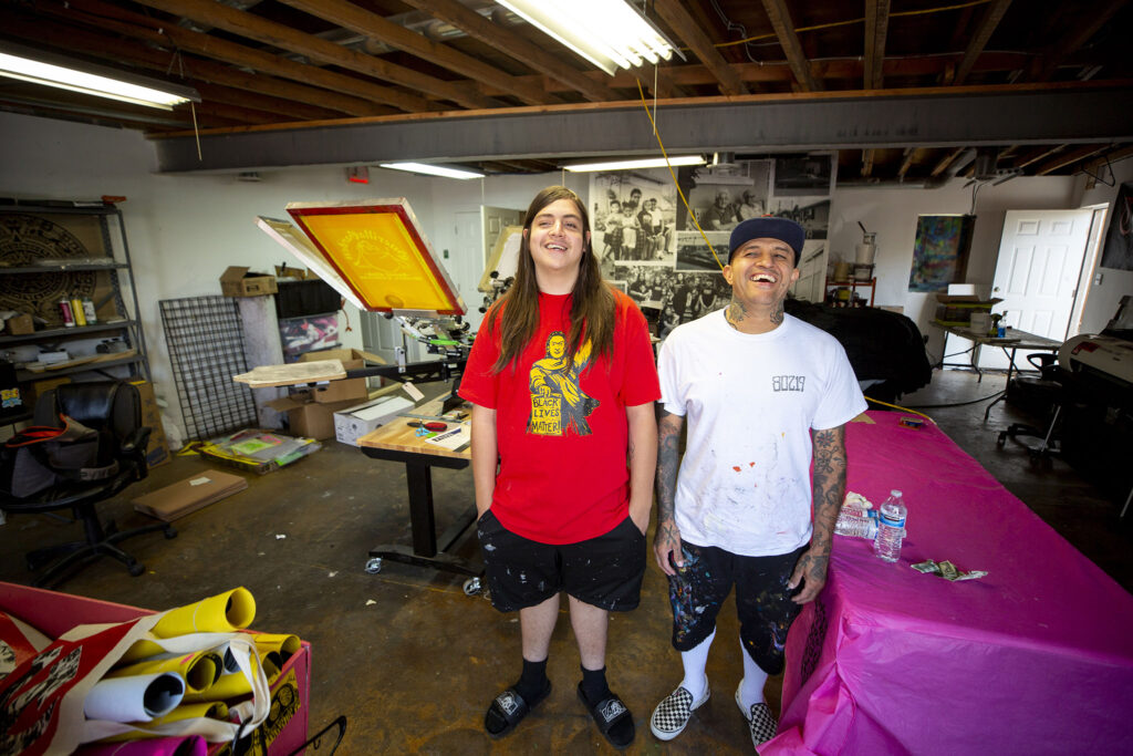 Santiago Jaramillo and his son, Zion, in Jaramillo's D3 Arts studio on Westwood's Morrison Road. Sept. 23, 2021.