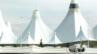 A guy walks on a roof outside of Denver International Airport. Oct. 1, 2021.