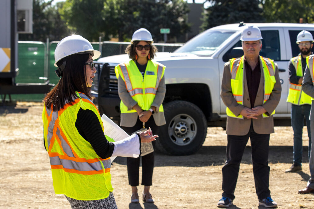 Theresa Peña, Denver Public Schools' regional coordinator of outreach and engagement for food and nutrition services, speaks during a ceremonial groundbreaking on a future greenhouse complex that will serve local students. Oct. 5, 2021.