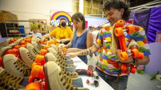 Frankie Toan (right) helps change roller skate wheels in Rainbow Dome's Valverde workshop. Oct. 5, 2021.