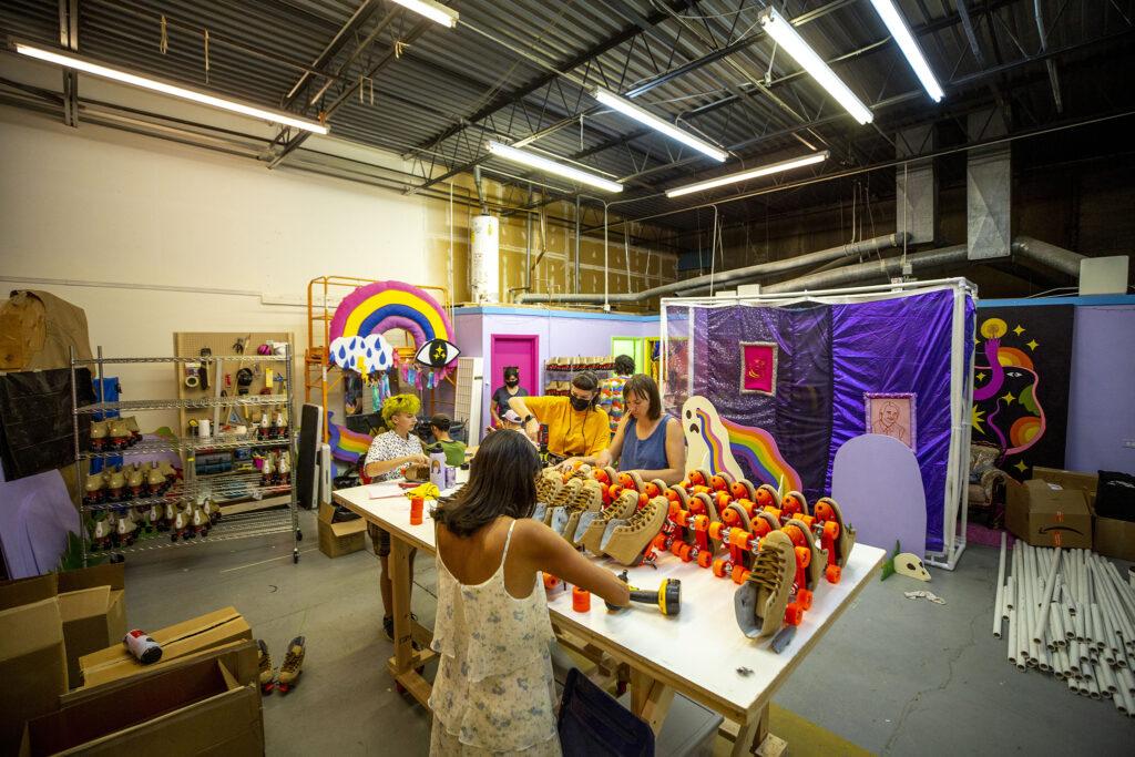 The Rainbow Dome team works on roller skates in their Valverde workshop. Oct. 5, 2021.