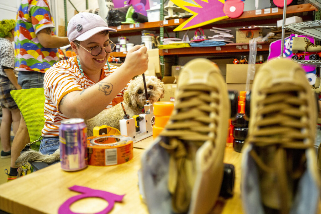 Therin Zimmerman works on a roller skate bearing in Rainbow Dome's Valverde workshop. Oct. 5, 2021.