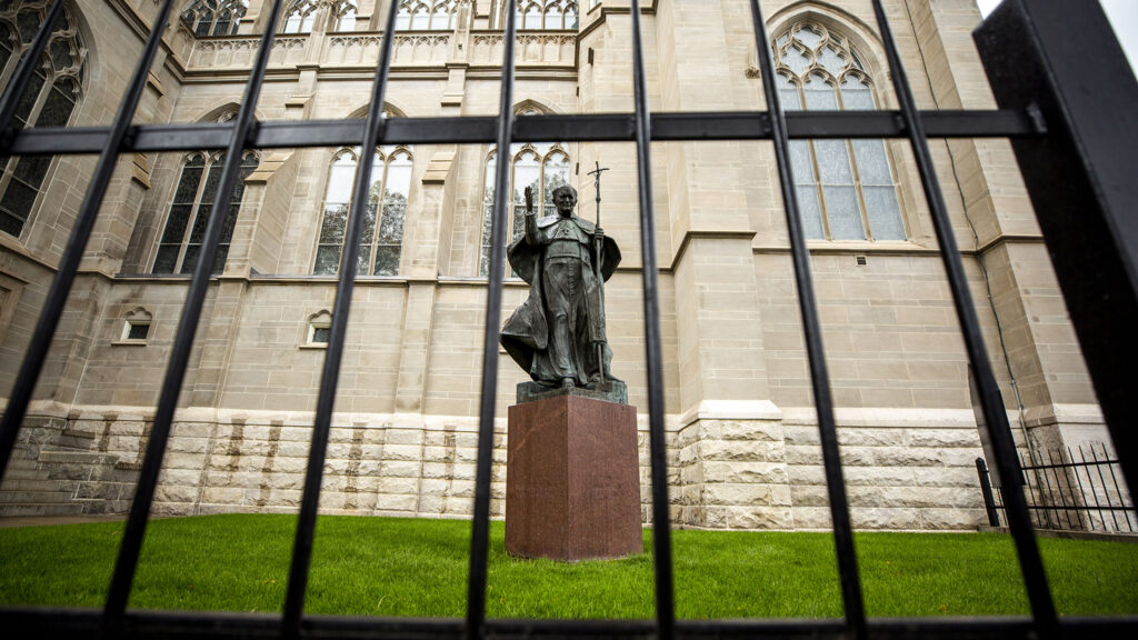A statue of Pope John Paul II at the Cathedral Basilica of the Immaculate Conception was recently vandalized. Oct. 12, 2021.