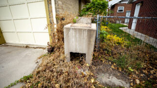 An old concrete incinerator in a Washinton Park West alleyway. Oct. 23, 2021.