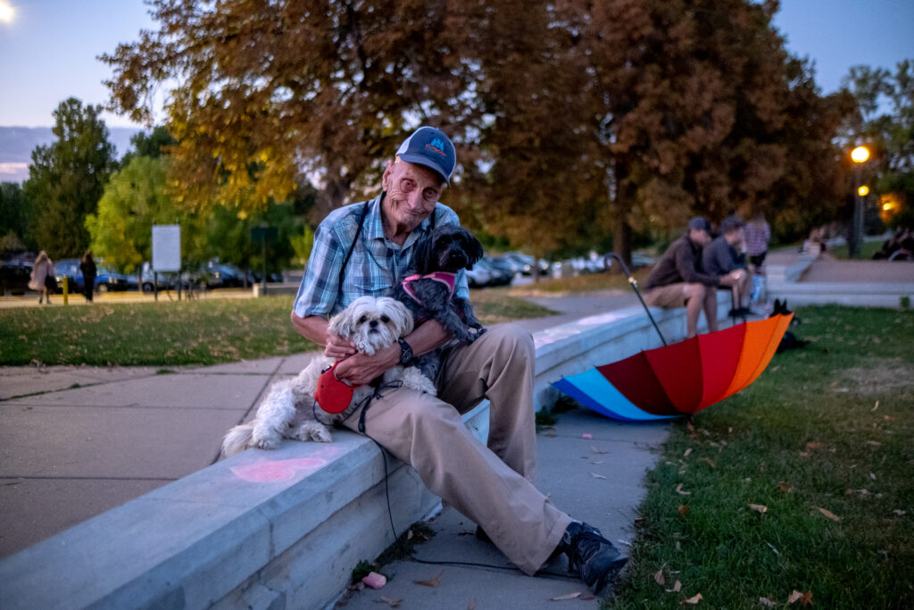 """Ron Arthur and his dogs, Seba and Steve, sit for a portrait at the 13th and final edition of Titwrench in City Park on Sunday, October 3, 2021. Arthur, who's been going through financial stress, was attending Titwrench for his first time. """"I wanted to get away for a day and walk around the lake and forget about everything. And then, I seen this fiesta here and I wanted to come here and see how things were going."""""""