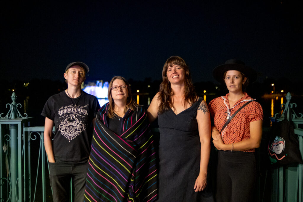 From left, Titwrench organizers Kate Warner, Katie Rothery, Sarah Slater and Michaela Perez stand for a portrait after sundown at the 13th and final edition of Titwrench in City Park on Sunday, October 3, 2021. Slater is also a co-founder of the festival.