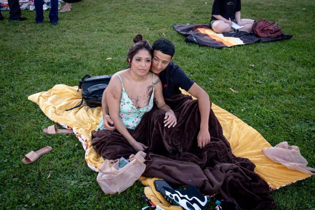 Shontae Gomez and Nicholas Herrera, husband and wife, enjoy live music together at the 13th and final edition of Titwrench in City Park on Sunday, October 3, 2021. The couple was walking through the park when they happened upon Titwrench and decided to check it out.