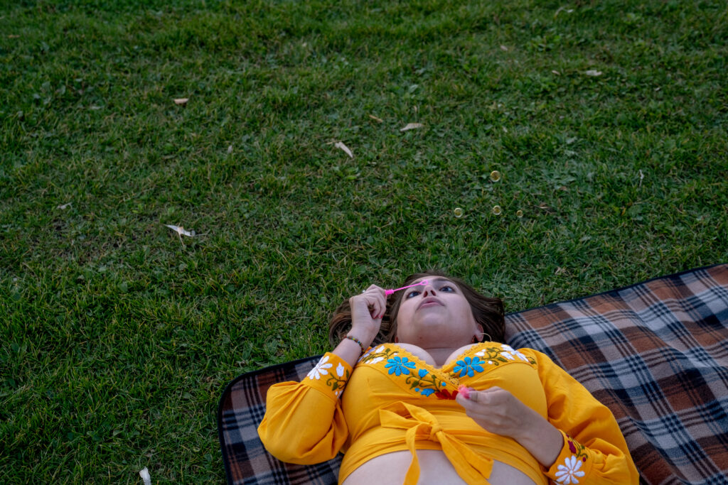 Angel, who preferred to go by her first name, blows bubbles while enjoying live music at the 13th and final edition of Titwrench in City Park on Sunday, October 3, 2021.